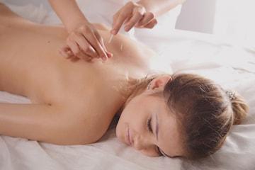Akupunktur och behandlande massage