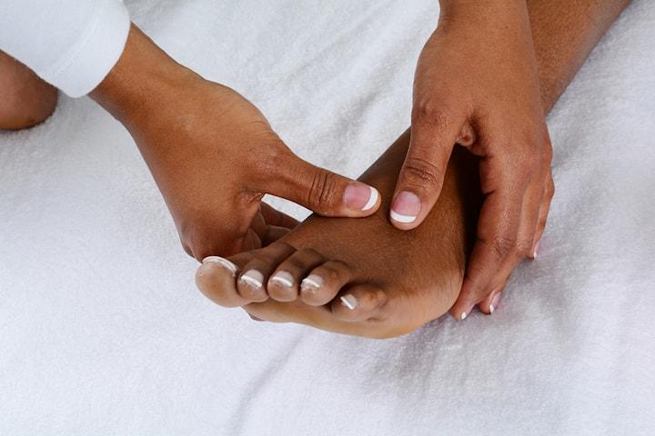 Behandlande och välgörande fotmassage, 50 min