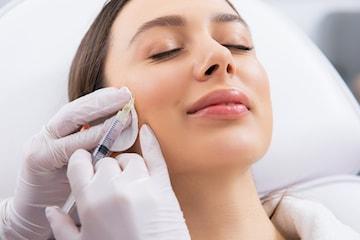 Botulinumtoxin-injektion utförd av leg. tandläkare
