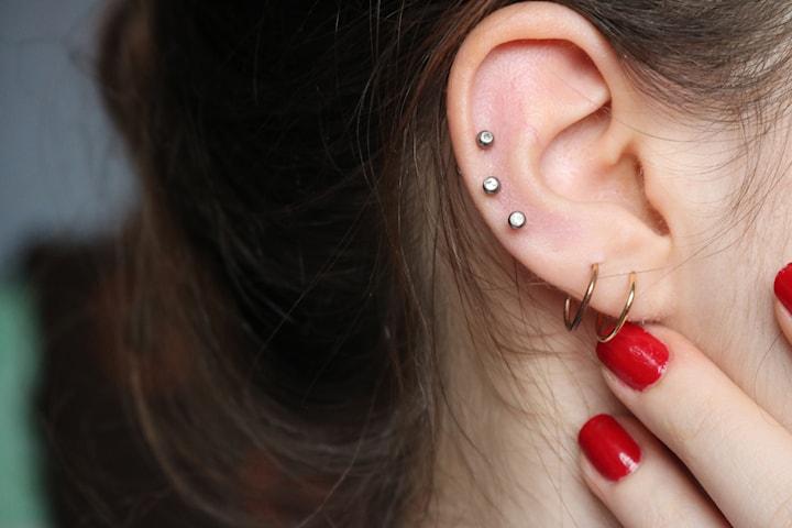 Ta hål i öronen med medicinsk håltagning