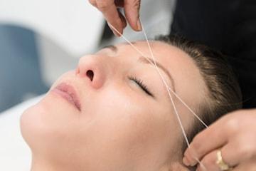 Trådning ansikte, ansiktsmassage och brynplockning
