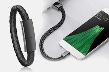 Armband och mobilladdare i ett