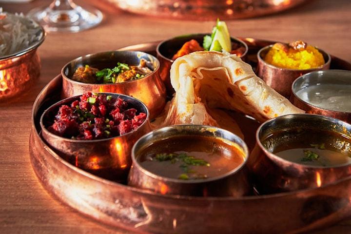 4-retters tasting meny, velg mellom vegetar eller kjøtt til 224,5 kr per person
