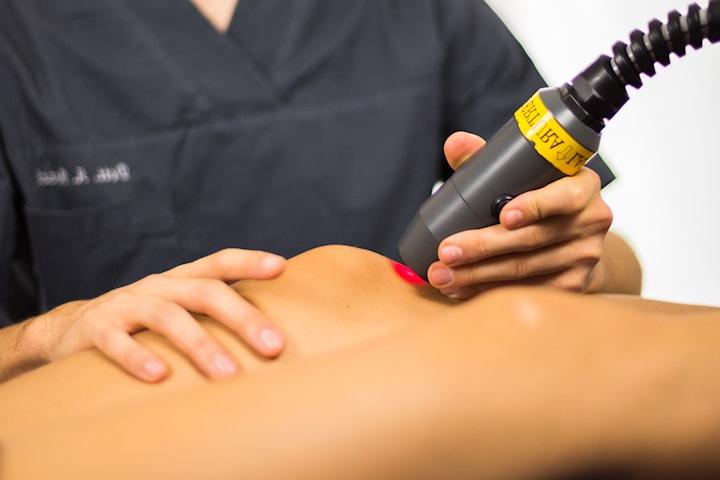 Medicinsk laserterapi med massage