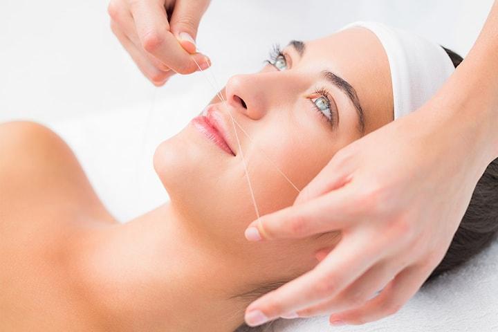 Hårfjerning med threading av hele ansiktet hos Beauty Senter