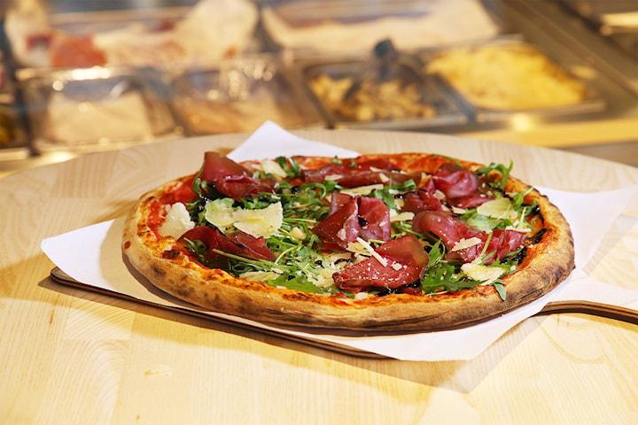 Valfri pizza på Fredo's pizzagastronomia!