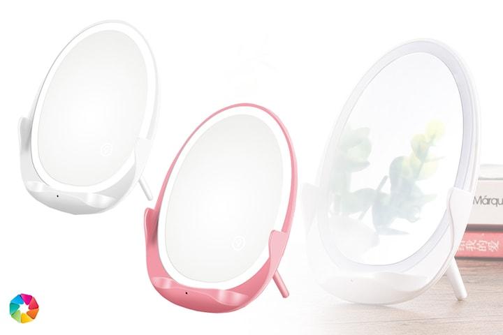 Ladda mobilen på smart sminkspegel med Qi-teknologi